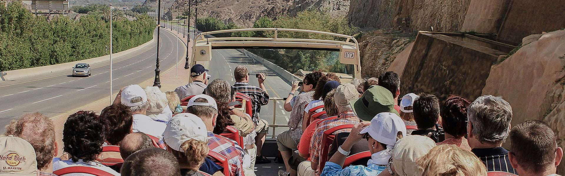 People on sightseeing bus tour in Muscat