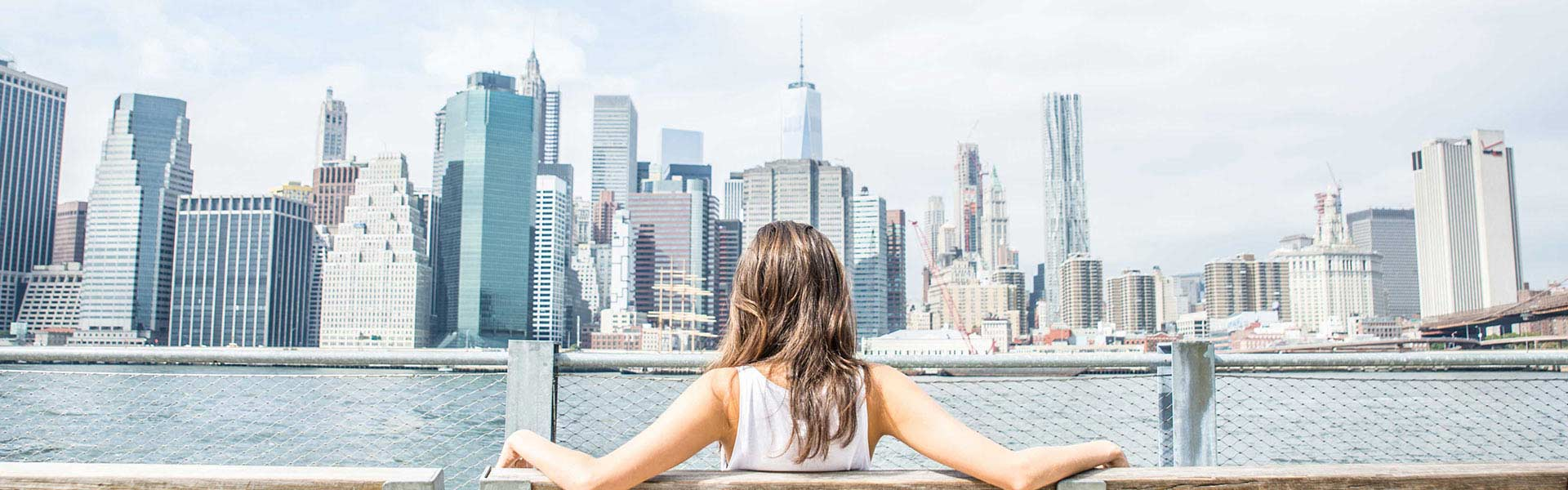 Girl looking at New York City skyline