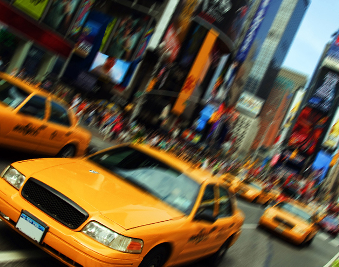 Yellow taxis driving through NYC