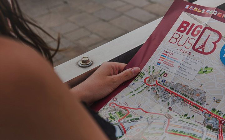 Girl looking at tourist map of Paris