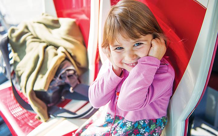 Little girl listens to commentary via headphones
