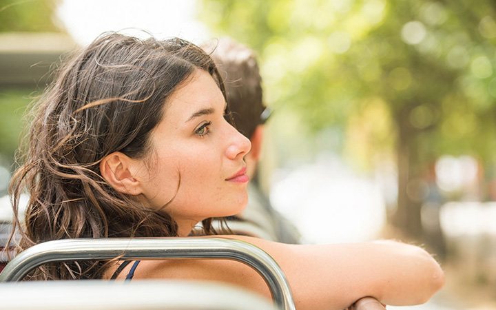Woman looks at Rome from Big Bus Tours top deck