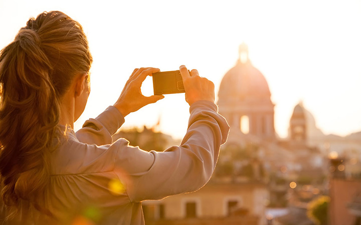 Woman photographs St. Peter's Basilica, Rome