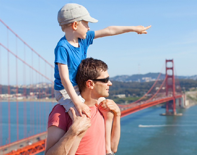father and child sightseeing the Golden Gate Bridge