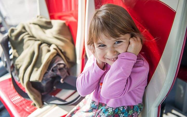 Little girl listening to Big Bus Vienna on board commentary via headphones